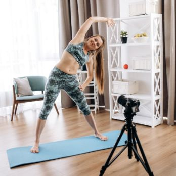 fitness instructor teaching in front of a camera at home