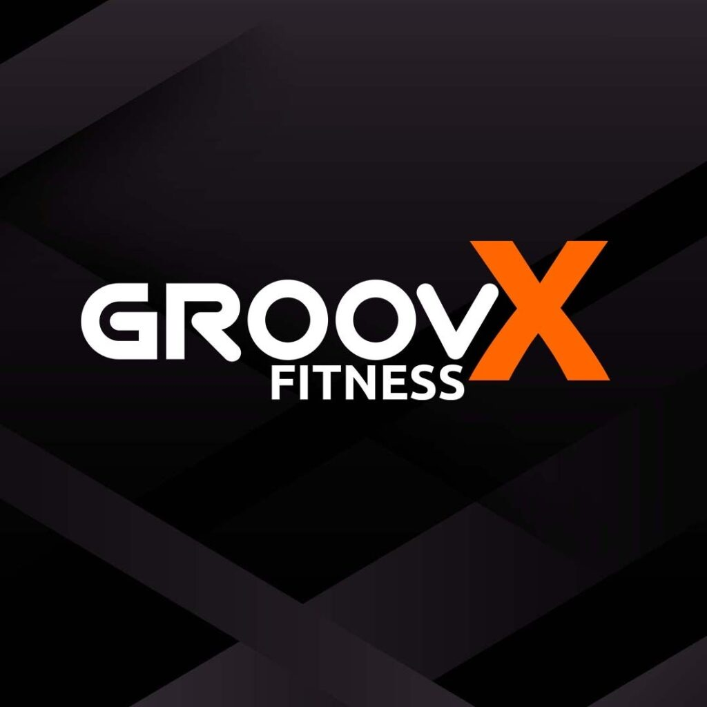 groovx Fitness logo, black background with white and orange text