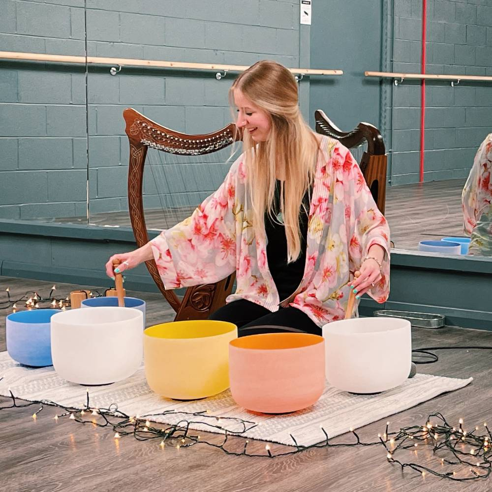 Hannah Rose performing a sound bath with tibetan bowls for Yoga classes